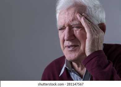 Old man feels pain in his temples