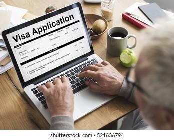 Old man filling out online visa application