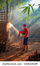 Old man fixing his net under ray of light in Bogor West Java Indonesia. 07 07 2019