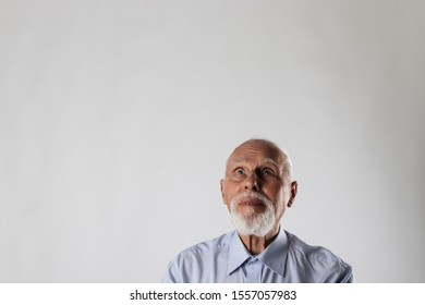 Old man is full of doubts and hesitation.