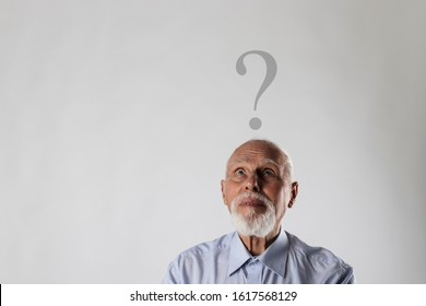 Old man is full of doubts and hesitation. Old man and question mark above head.