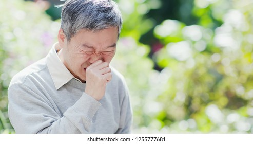 old man get a cold and cough outdoor