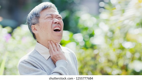old man get a cold and feel throat pain outdoor or symptom of esophageal cancer