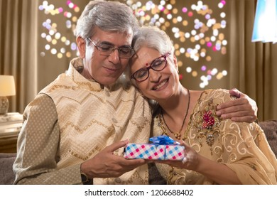 Old Man giving Diwali gift to his wife on diwali celebrations