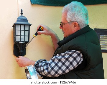 Old man with glasses posing for portrait