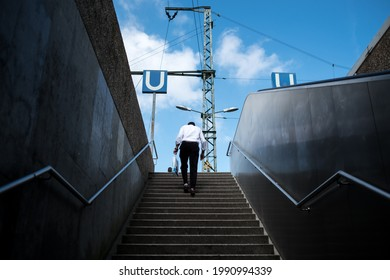 Old man going up to the railway station in Cologne