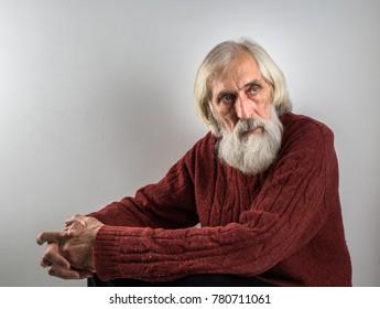 An old man with a gray beard.