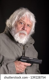 Old man with a gun (automatic pistol)