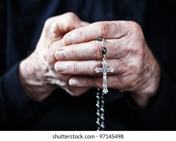 old man hands with classic rosary