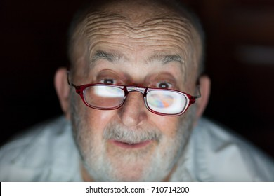 old man happy about his business growing with pie chart reflection on glasses
