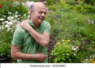 Old man having lumbago pain