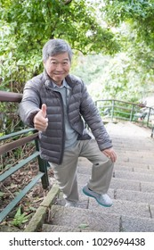 old man with health knee and climb moutain