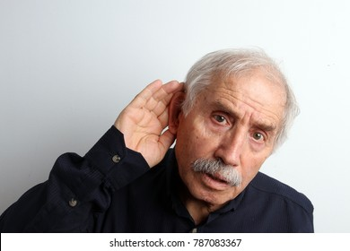 An old man with hearing disability trying to hear something