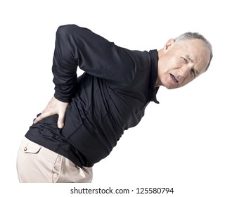 Old man holding his painful back isolated in a white background