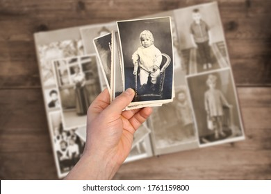 old man holds his old photos taken in 1960-1961, album with vintage monochrome photographs in sepia color, the concept of genealogy, memory of ancestors, family ties