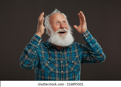 old man with a long beard with big smile on a dark background