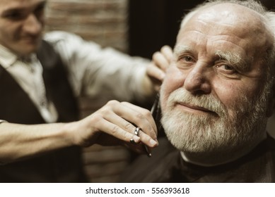 old man looking at the camera in barbershop