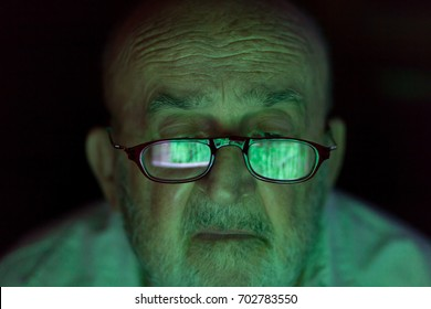 old man looking at a hacked computer screen