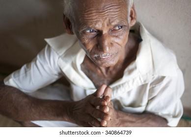Old man looking up and praying - MAY 20th 2015; JEYPORE - INDIA