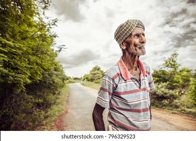 Old man looking at the sky on nature background.