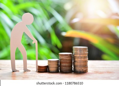 old man model walking to money coins saving for concept investment mutual fund finance and pension retirement