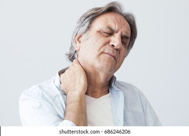 Old man with neck pain