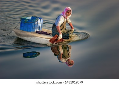 Old man on the thermocol boat outing for fishing in Water area. City : Dammam, Country : Saudi Arabia.Photo was taken Month of March 09 Year 2018.