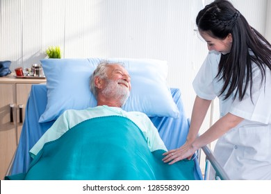 a old man or patient or elder sleeping on bed in hospital with doctor or nurse to take care and holding hands as health caring - Shutterstock ID 1285583920