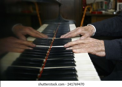 Old Man Playing The Piano with its dilapidated hands
