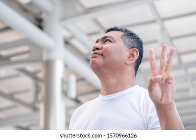 old man pointing up three fingers for three points counting; senior old man model for senior citizen, pensioner, retired man concept usage