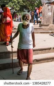 Old man portrait while walking on the streets of Kashi with stick  : Varanasi, UttarPradesh/India - April 2019