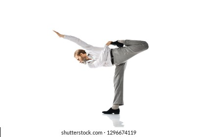 Old man practicing yoga classic asana dance pose stretching on hands against white background