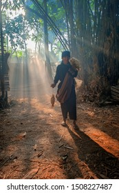 Old Man returning to his home under ray of light in Bogor West Java Indonesia. 07 07 2019