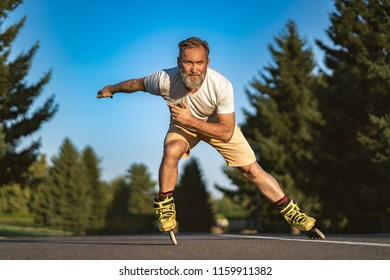 The old man rollerblading on the alley