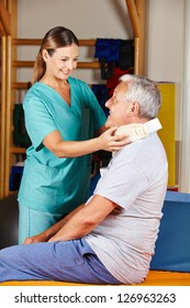 Old man with ruff neck and nurse at a physiotherapy