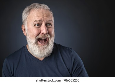 Old man in shirt and scared looking a way