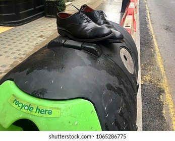 Old man shoes on recycle bin
