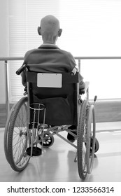 Old man sitting on wheelchair in hospital