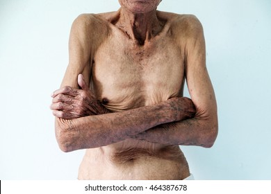 old man Skinny torso in a white background.