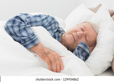 Old man sleeping on the bed