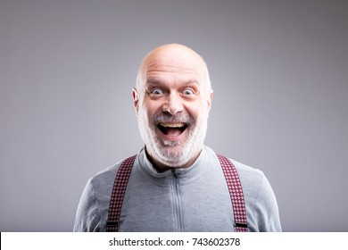 old man smiling in a very exaggerated facial expression