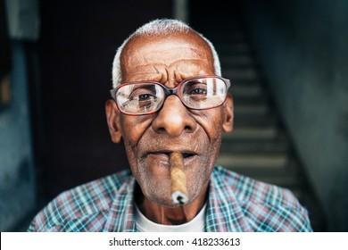 Old man smoking cigar in Cuba