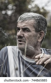 Old man smoking cigarette,black-white,portrait
