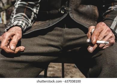 Old man smoking outdoors. Dependence of smoking
