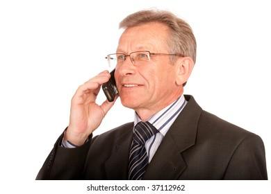 Old man speaks by mobile phone.