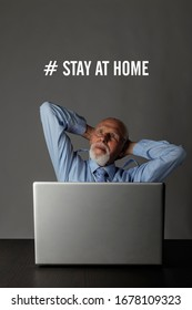 Old man is staying at home during the COVID-19 coronavirus outbreak. Senior worried about the Coronavirus and working from home. Stay at home social media campaign for coronavirus prevention.