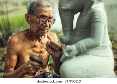 Old man stone carving