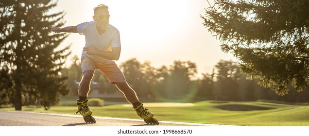 The old man in sunglasses rollerblading outdoor