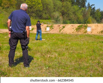 Old man trains shooting at open shooting range