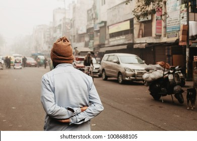 Old man walking on Delhi street